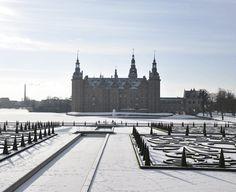 Frederiksborg Castle in winter seen through the garden