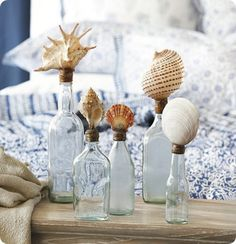Seaside Bottles with shells for a nautical accent beach house coastal cottage chic home decor by Ballard Designs Altered Bottles, Bottles And Jars, Perfume Bottles, Glass Bottles, Seaside Decor, Coastal Decor, Coastal Cottage, Cottage Chic, Seashell Crafts