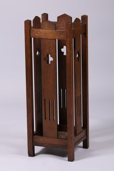 "Mission oak single umbrella stand with cutout clover design. Unsigned. Original finish with original drip pan. 32""h x 11"" square"