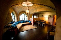 Hvittrask, the home of Eliel and Loja Saarinen in Finland before they moved to the States and helped establish Cranbrook. This room is so appealing - the low couch with the thick pile ryijy rug, the tiled fireplace, and the wall and ceiling murals. On my list of places to visit!