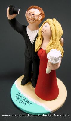 """Selfie"" Wedding Cake Topper  ....ok....say cheese!....you know when the 2 of you are on a vacation or just hanging around town and want to take a picture of yourselves...?...you do the self portrait thing with the iphone, cel phone, digital camera or whatever device you favour.$235#iphone#camera#photographer#cel_phone#wedding #cake #toppers  #custom #personalized #Groom #bride #anniversary #birthday#wedding_cake_toppers#cake_toppers#figurine#gift#selfie"