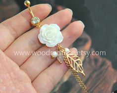 White Flower Belly Button Ring ,White Flower Belly Ring with gold leaf ,peal,beads,Dangle Belly Ring , Floral Belly Button Piercing by woodredrose on Etsy https://www.etsy.com/listing/203935241/white-flower-belly-button-ring-white