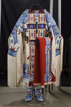 oyce Growing Thunder Fogarty (Assiniboine/Sioux, b.1950), Give Away Horses Dress, 2006, Montana. Hide, seed beads, thread.; Breastplate and belt drop by Juanita Growing Thunder Fogarty, b. 1969.; Blanket by Jessica Growing Thunder b. 1989.