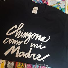 Chingona Como Mi Madre A Very That original design My Mami, Estela, was born in Rosita, Coahuila Mexico. Es la mas chingona de las chingonas, always brave, always hilarious, and always supportive. She is the muse behind the majority of my work, she is my best friend, and she is the most badass woman I know. I hope to be chingona como mi madre one day. This is the only color available at the moment. Tees are 100% cotton, pre-shrunk. Stay tune for more designs, color, and size options coming…