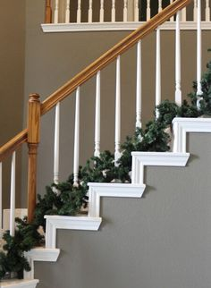 Garland at the bottom of the stair spindles