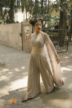 Sapana Amin Light grey silk crepe crop top with side cut-outs & hand embroidery paired with matching palazzo pants & a thread work and sequin embroidered cape with silk crepe finishing.