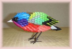 This 3D origami, Painted Bunting bird, is composed with a total of approximately 350 Chinese modular triangular units and each triangular unit is folded using a single small rectangular sheet of paper.