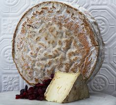 Tomme Crayeuse - Schmidhauser. Aged two to three months in a warm moist cave, this cheese has a dense, semi-soft, ivory paste. The chalky wheel is greyish brown with yellow chalky patches that develop as the cheese ages. The flavor is complex, earthy and mushroomy.