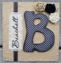 burlap shadow box with my new initial? And perhaps our anniversary date embroidered underneath? Miiiiichaaaaeeellls!