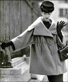 1958 Simone D'Aillencourt in camel-hair coat featuring large collar and 34 sleeves by Lanvin-Castillo, gloves and handbag by Hermès, Paris