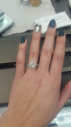 Obsessed with the details on this fabulous engagement ring! From the double halo to the twisted band, this is perfect.