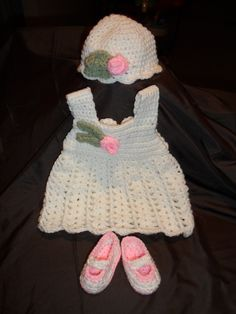 """This adorable Baby Girl Layette includes a crochet dress, hat and booties. Back opens to allow getting the dress onto the baby, and Closes using the crochet button! The size shown is intended for a baby 0-3 months of age. Measurements are as listed below:    Hat: 6"""" Wide x 4 1/2"""" Tall   Dress: Chest: 7"""" Wide x 3 1/2"""" Tall   Straps to brim of dress: 12""""   Booties: 4"""" long x 1 1/2"""" deep    Other Sizes Available:   US Newborn   US 0-3 Months (As shown)  US 3-6 Months  US 6-12 Months"""