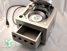 Hey, I found this really awesome Etsy listing at https://www.etsy.com/listing/98162600/upcycled-gamecube-desk-organizer-with