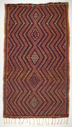 5♦ Africa | Rug from the Berber, Beni M'guild tribe from the Middle Atlas Mountains in Morocco | ca. 1940 - 70 | Wool and plant fiber; Soumak, supplementary weft, braided, fringed, knotted pile.