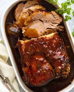 Slow Cooker Pork Loin Roast in a white dish, ready to be served
