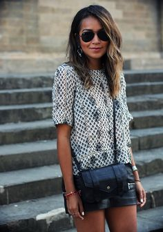 Julie Sarinana is wearing a floral top from ASOS, leather mini skirt from Zara and a PS1 wallet from Proenza Schouler
