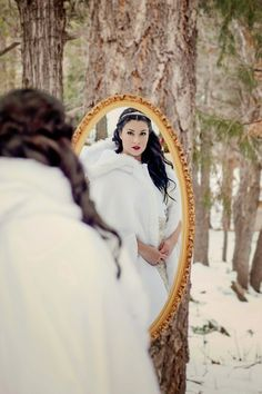 Snow white themed anniversary shoot. Girl knows how to play to her coloring.