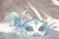 "This could be a nice ""something blue"" http://www.justposhmasks.com/product/97/Tiara_Feathered_Venetian_Masquerade_Masks_-_DANIELA_SILVER"