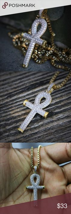14k Gold Egyptian Ankh Key Of Life Cross Lab Simulated Diamond 14k Gold Egyptian Ankh Key Of Life Cross Pendant Necklace Chain is 14k Gold And Rhodium Plated over 316 stainless steel. White lab simulated diamonds. Pendant is 33mm in length. Ts Verniel Accessories Jewelry