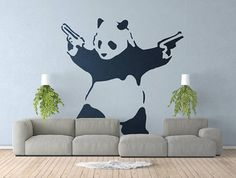 Armed Panda Wall Decal Sticker Banksy Style | Urban art | Artist graffiti stencil urban walls wallart spray | Wall Art | Panda with guns by BrutalVisual 7.50 EUR Pandas look so cute and it is hard to imagine one handling guns let alone using them. In this decal we have a black-and-white rendering of a panda bear with handguns in its front paws. The guns are held high; the panda looks to its right. A surprise in researching this print is that it is not the work of Banksy. He does not know why