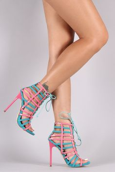 This striking open toe heel features a strappy construction with corset-style lace up closure, colorblock design, and glossy stiletto heel....