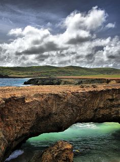 An HDR of a naturally formed bridge on the coast of Aruba.