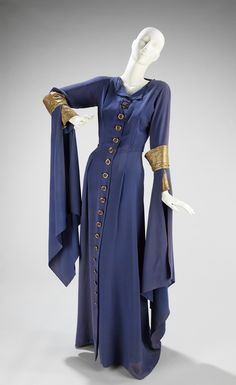 "Evening Dress, Jeanne Lanvin (French, 1867–1946) for the House of Lanvin (French, founded 1889): fall/winter 1934–35, French, silk, metal. ""This particular shade of blue is known as ""Lanvin blue."" The shade was one of the many designer colors which Lanvin had produced in her dye factory in Nanterre, France. The color could not be reproduced and therefore was never subjected to reproduction as was many of the designer garments in this period where design theft was rampant..."""
