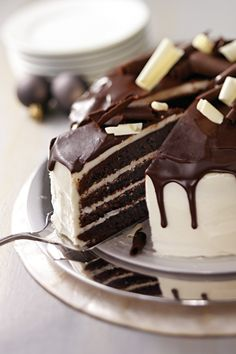 Tuxedo Cake - When the occasion calls for something elegant, this dramatic-looking chocolate Tuxedo Cake with white frosting and chocolate glaze is the one to make!