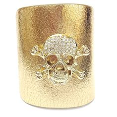 """This leather cuff is constructed of thick, resistant, genuine leather, has a snap closure feature, and is accented in a crystal-studded skull matching the leather color. The cuff is adjustable for a desirable fit. Material: Genuine Leather - Size: 10"""" Long x 3"""" Wide - Color: Gold $39.99"""