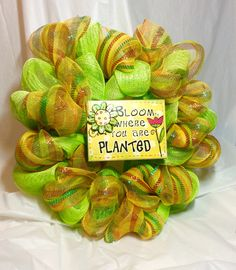 "Mesh wreath. 8x6"" wooden sign is surrounded by lime green mesh"