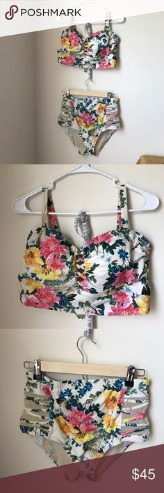 Make a splash! Cutest Torrid floral suit! This pretty floral suit is revealing in all the right ways! I adore it, but have lost weight and it doesn't fit anymore. Breaks my heart to sell it. I've only worn it 2-3 times. It's a Torrid size 0. torrid Swim Bikinis