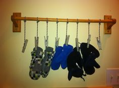 Simple wet mitten storage.    Our entry way is small, there was no where to put wet mittens.  They ended up on lying about on registers and we were always looking for them.  To fix this, I put up a towel bar, tied some clothes pins to it, and voila - wet mittens have a home where they dry nicely and are easily found.