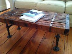 Modern industrial coffee table, reclaimed barnwood with steel pipe legs. $375.00, via Etsy.