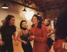 A special candid moment of Michael with his dancers, circa 1997.