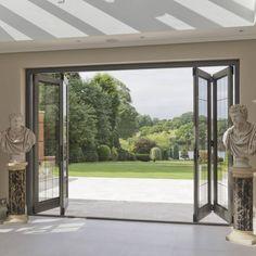 Bi-folding Timber Doors with Bronze Inserts:  Windows & doors  by Architectural Bronze Ltd