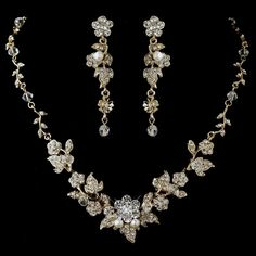 Floral and stunning, this gold plated jewelry set is the perfect accessory to your spring or summer wedding. Gorgeous leaf details, glistening rhinestones, and the option for white faux pearls dazzle