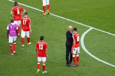 Vladimir Petkovic head coach of Switzerland in conversation with Granit Xhaka of Switzerland  during the UEFA EURO 2016 Group A match between Romania and Switzerland at Parc des Princes on June 15, 2016 in Paris, France.