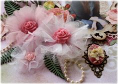 Tulle flowers; cut tulle into circle or scallops using scissors or a die, fold into fourths, and glue down.