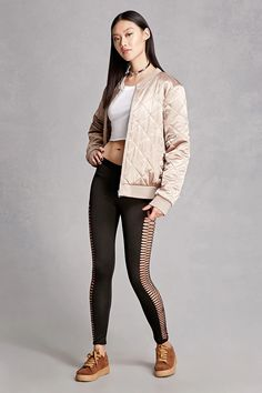 A pair of textured stretch-knit leggings by Kikiriki™ featuring raw ladder-cutout sides and an elasticized waist.