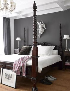 White walls with dark grey feature wall for the hall for Grey feature wallpaper bedroom