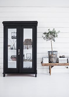 black cabinet and white floor