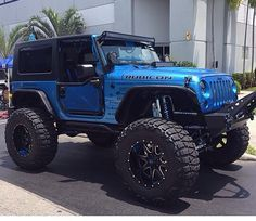 BLUE 2 DOOR WITH A 6 IN LIFT CUSTOMIZED WITH GREAT LOOKING WHEELS &  MODIFIED JEEP RUBICON