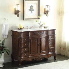 Adelina 48 inch Old Fashioned Look Bathroom Vanity httfeatures fine hand construction and hand carved details of the classic scrolling acanthus leaf design. Give your bathroom an upscale appearance with this striking Bathroom Sink Cabinet. This piece is carefully handcrafted of sturdy wood. A smooth, rich oak finish brings out the luster of the wood, while enhancing the intricate carved acanthus leaf details.
