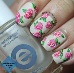Here's a nail art in the midst of all these swatch post  It's a floral patterned manicure with a twist of a matte finish. Read more here: http://nicethingstolist.blogspot.sg/2014/08/simple-floral-nail-art.html