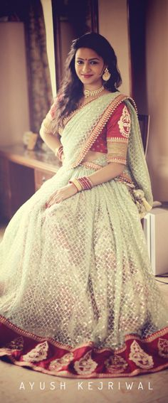 desi bride, red and cream lehenga for an Indian wedding.  Indian bridal outfit.