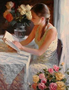 Reading at the table.