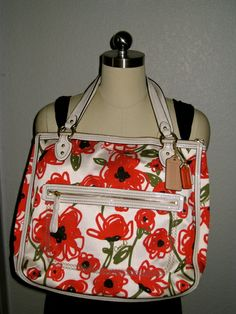 'COACH Poppy Floral Print Hallie EW Tote PreLoved' is going up for auction at  8am Fri, Apr 25 with a starting bid of $40.