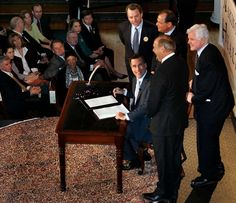 The G.O.P. Bill Forces States to Build Health Systems From Scratch. That's Hard.  -  September 21, 2017:   Mitt Romney, then the governor of Massachusetts, signing the state's landmark health care bill into law in 2006.