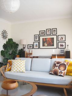 My photo wall and Ercol daybed, cushions by emmalovesretro.