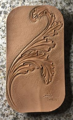 leather carved acanthus leaves